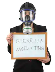 Man holding Introduction to guerilla marketing sign